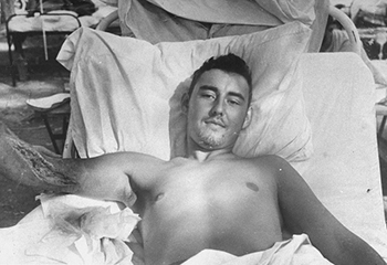 An American serviceman gets open-incision treatment. (Photo from PURE GRIT)