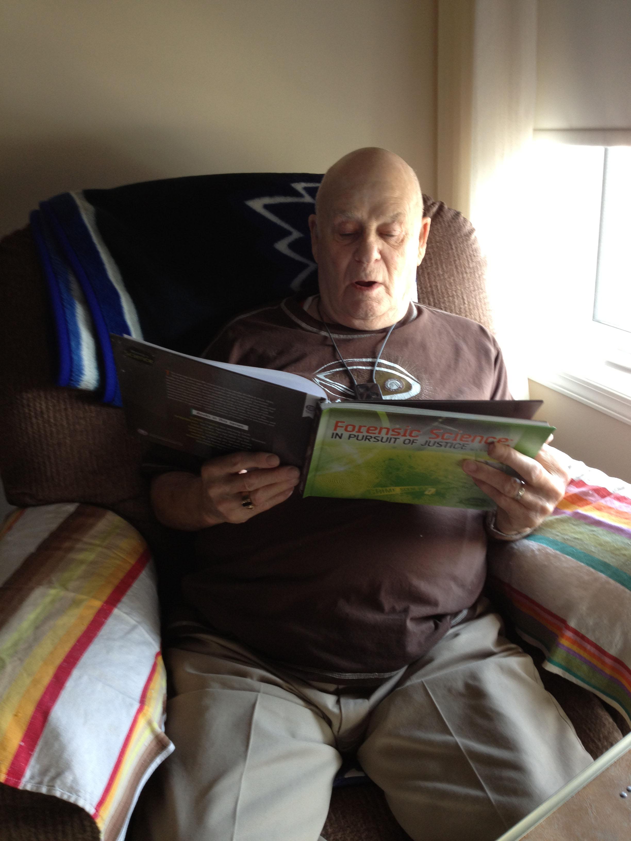Grandpa Carmichael perusing my latest book!