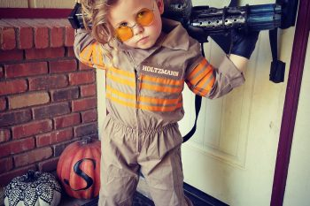 Young girl dressed as Holtzmann from Ghostbusters