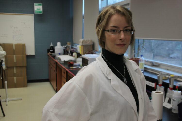 Lindsey Carmichael wearing a lab coat